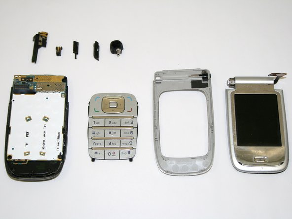 With the front half of the phone, push the keypad towards the removed portion of the phone.