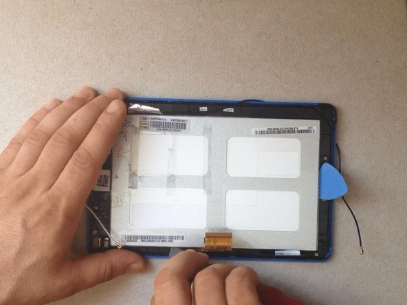Use a cutter and a plastic tool to separate the LCD.