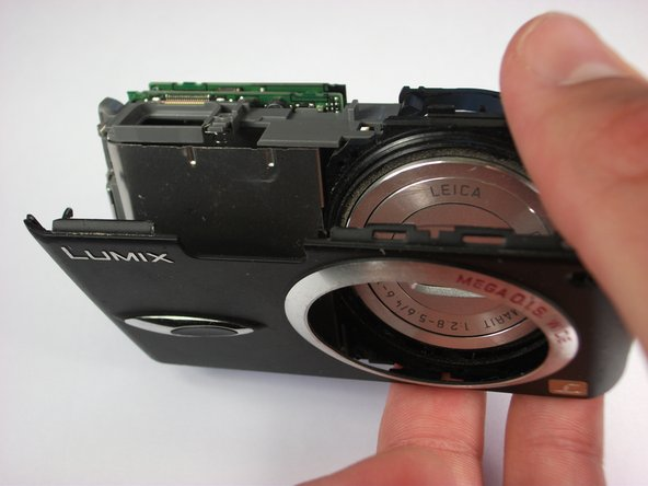 Carefully remove the front casing after verifying that the thin plastic around the lens is not still attached.