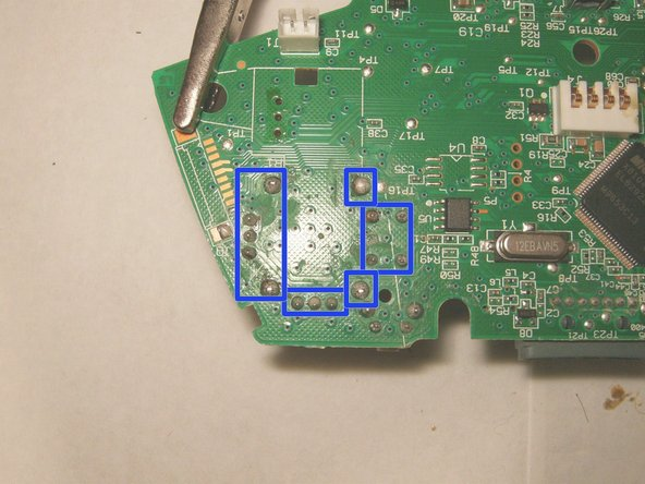 Image 3/3: With the left trigger removed, simply turn the logic board over and find the 14 solder connections