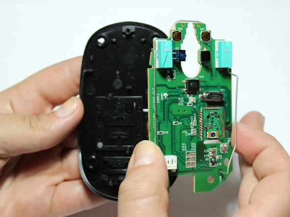 Manually remove the circuit board from the base of the mold housing.