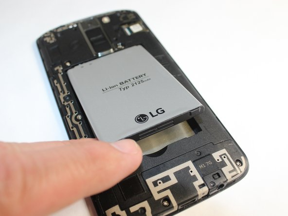 Remove the battery from the phone by lifting up on the bottom end of the battery.