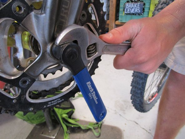 Image 2/2: Slightly tighten it with an adjustable wrench.