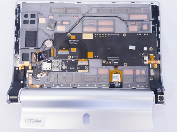 Using the blue opening tools or spudger, gently remove the back cover to expose the interior of the tablet.