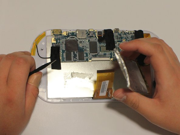 Now remove battery. The battery should still be pried from the LCD display, if not pry it again.