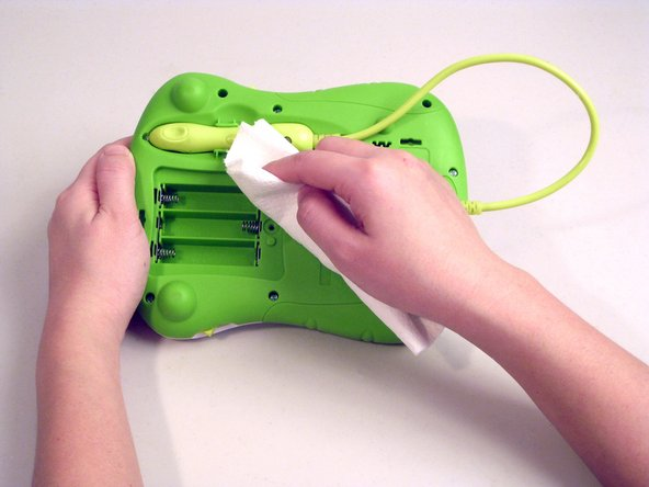 Wipe the metal terminals and the toy clean using a soft, dry towel.