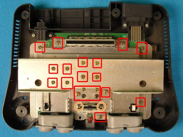Image 1/1: Also remove the two smaller screws on the expansion slot.