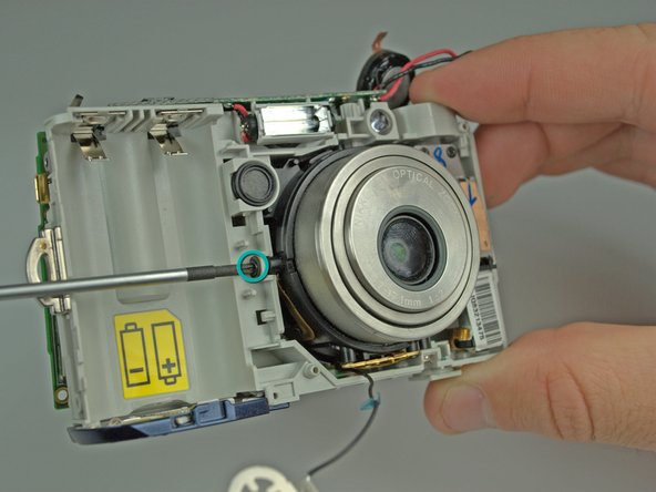 Remove the 3 screws holding the lens to the camera frame.