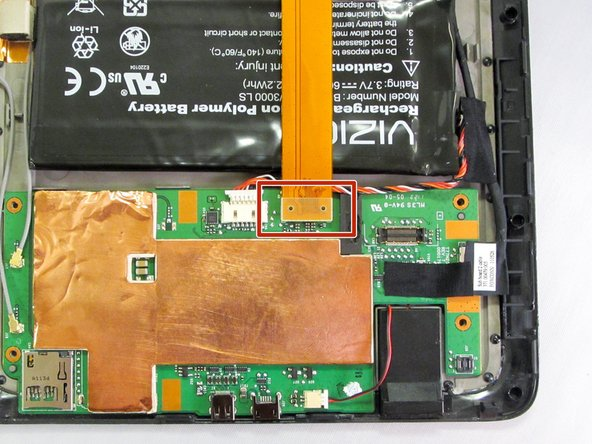Remove the ribbon connector at the top of the mother board using the  opening tool.