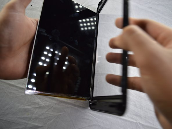 Remove the screen by holding the tablet in one hand with the back of the LCD screen facing up. Slowly rotate the tablet so the screen falls into your other hand.