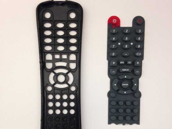 Remove plastic molding attached to the top half of the remote casing