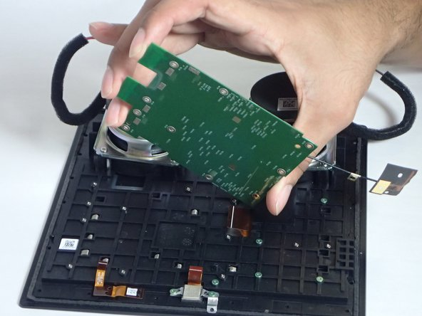 Once all the screws have been removed, you should be able to gently lift the motherboard up and out of the device.