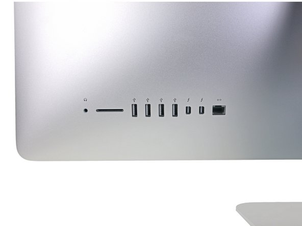 When reinstalling the logic board, check the alignment of the exterior I/O ports. The logic board can sit crooked even when secured with all its screws.