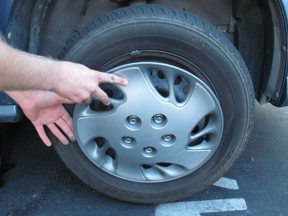Image 2/2: When putting the hub-cap back onto the wheel, tighten the lugs until you feel firm resistance. Do not over tighten because the threads will strip.
