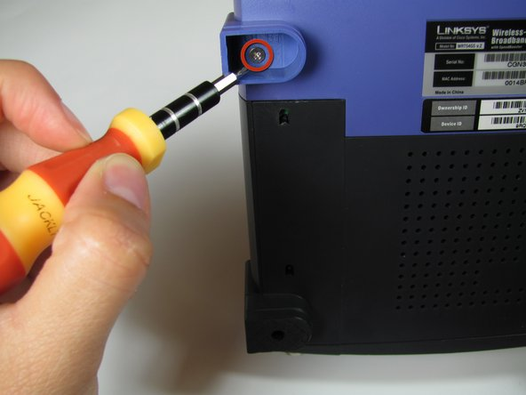 Use a Phillips #2 Screwdriver to remove the two 5.8 mm screws holding the front case to the motherboard.