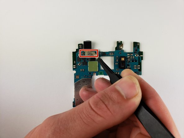 Use tweezers to remove the connection between the motherboard and the front camera.