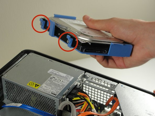 Flip the hard drive so that the blue case is facing down, and the marked tabs are facing toward you.
