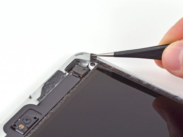 Image 1/3: So far it looks like Apple has more tricks than treats for us with a hidden screw securing the display.