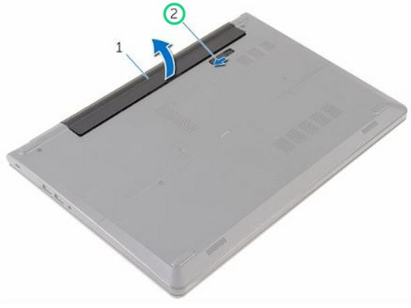 Slide the tabs on the battery into the slots on the battery bay and snap the battery into place.