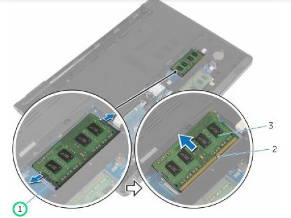 Using your fingertips, carefully spread apart the securing clips on each end of the memory-module slot until the memory module pops up.