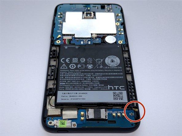 Using Tweezers, disconnect antenna wire.