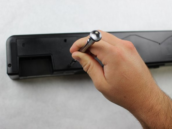 Remove the five 18.25mm screws with the Phillips #2 screw driver.