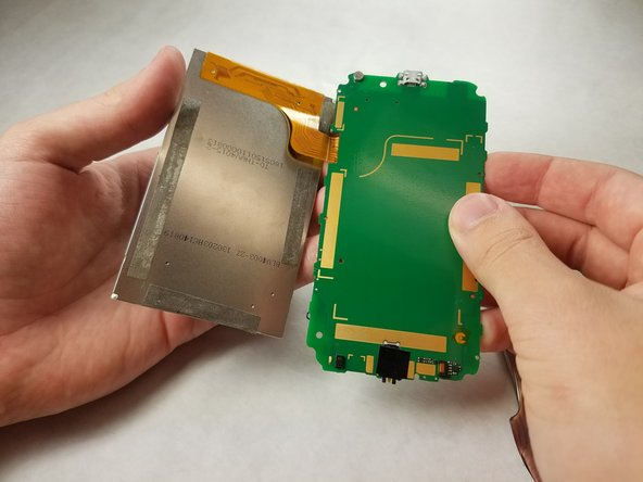 Using your hands, gently remove the ribbon connecting the digitizer to the circuit board.