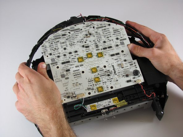 Pull the mother board up off the Roomba
