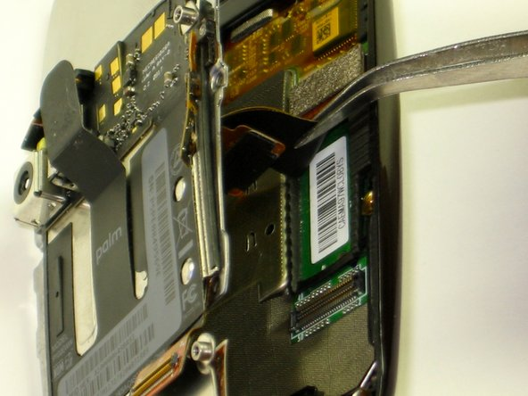 Image 2/2: Do not tear the ribbon cables when removing the backing plate. Instead use tweezers to remove them.