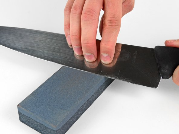 Once the knife has been uniformly sharpened on both sides of the blade, wipe it with a towel (without slicing yourself) and inspect its edge.