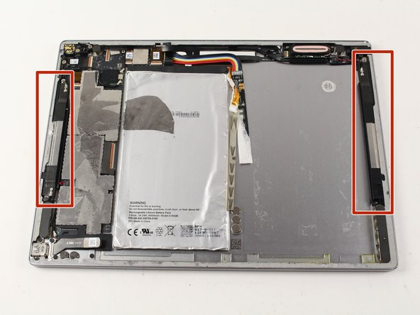 Locate the thin black speakers along the right and left sides of the tablet.