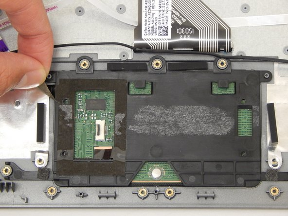 Remove the black tape on the left side of the touchpad.
