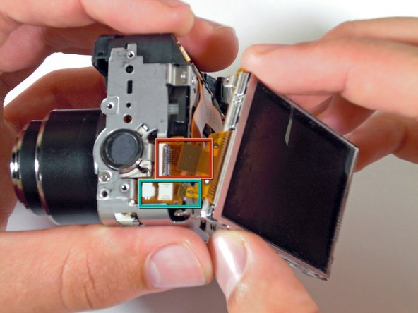 Image 2/2: Unplug the narrow ribbon cable to free the LCD screen from the camera body