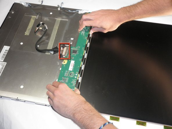 Image 1/1: Use both hands to remove the circuit board. The screen is attached to the circuit board, so do not pull by the screen.