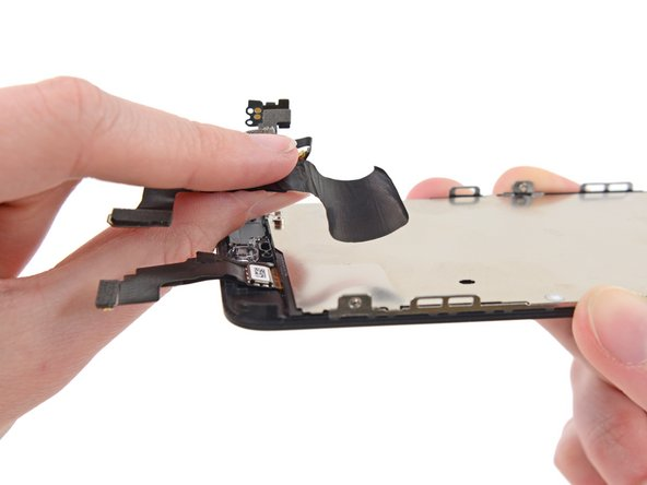 Be careful not to grab the digitizer or LCD cables while peeling up the front-facing camera and sensor assembly cable.