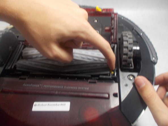 Pull out the main brush, similar to removing a set of batteries from a remote.