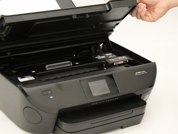 Lift the scanner to open up the printer cartridge access area.