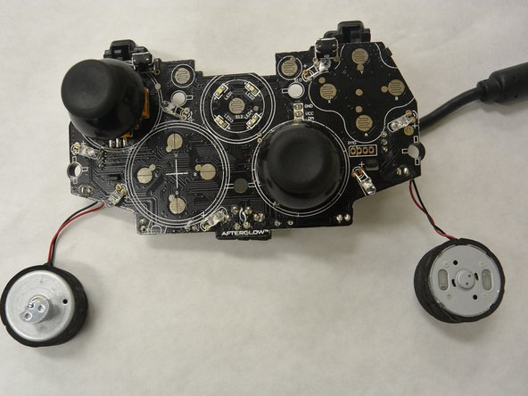 The rumble motors are located in the bottom right and left hand corners of the controller.