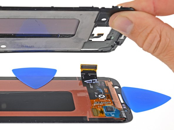 Route the display's flex cable through its hole in the frame in order to fully separate the right edge of the display.