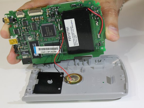 Insert new battery where old battery was.