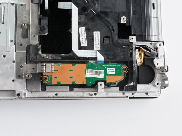 Image 1/3: Using a flat edge tool, and your index finger began to slowly move the logic board out of it's slot.