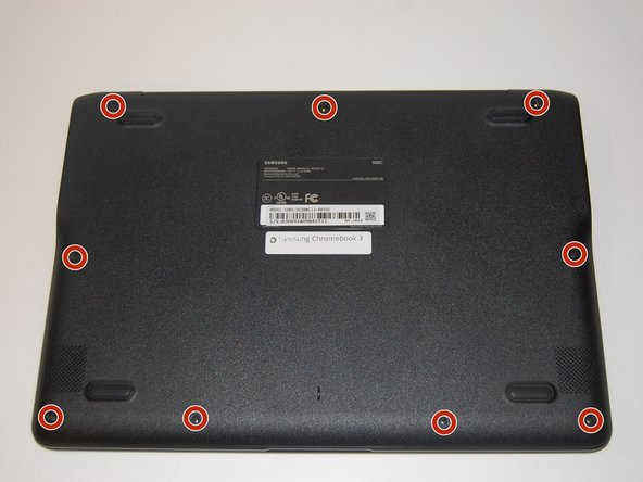 Place the laptop back cover facing up to expose the screws.