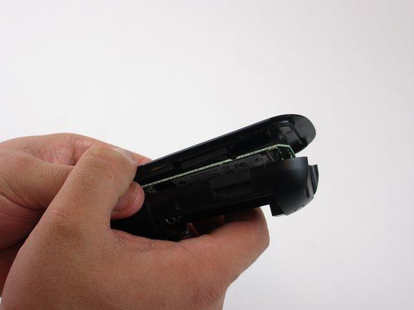 Lift the top of the remote off very carefully so that board does not fall