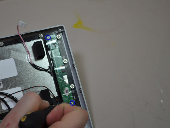 Image 1/1: Remove the two 5mm screws with your Phillips #0 screwdriver.