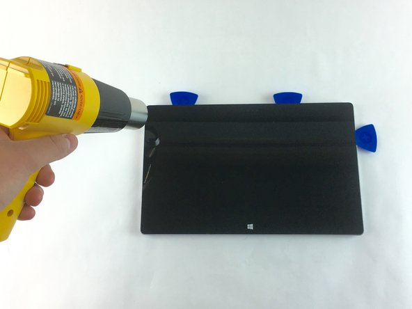 Image 1/3: Avoid holding the heat gun too close to the Microsoft Surface 2 so as to not cause any unwanted warping.