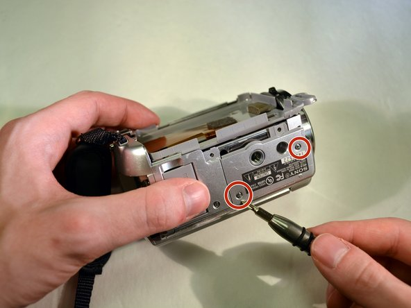 Image 1/3: Remove the bottom case panel.