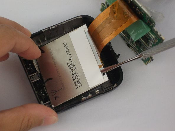 Use the metal spudger to remove screen from device.
