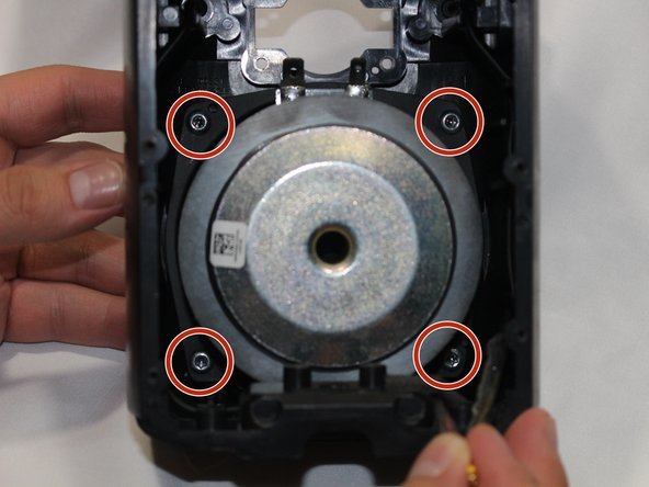 Remove the 4 10.0 mm silver screws which hold the woofer in place using the T20 bit and driver.
