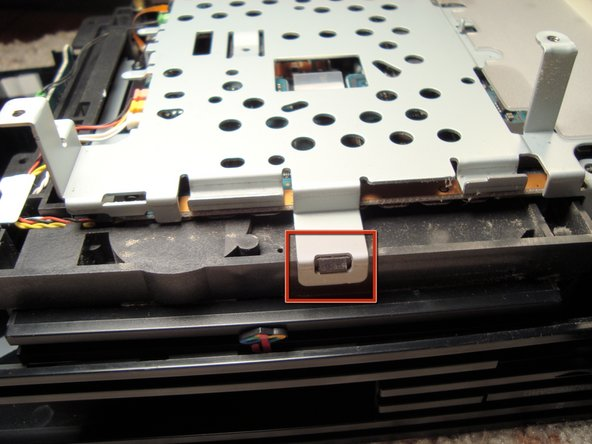 Image 3/3: Once all the screws are gone we can lift the metal frame by using a flathead screw and some leverage to unlock all four sides from the plastic case of the optical drive.