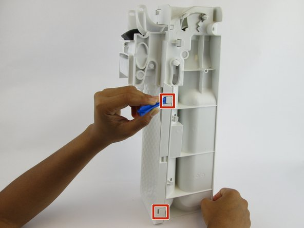 Lift the clips located on both sides with the plastic spudger. Slide the front cover off.